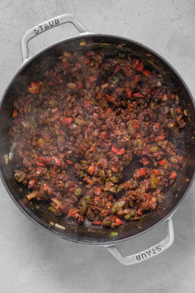 sautéed onions and bell pepper with spices and tomato paste