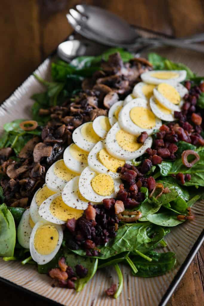 Warm Spinach Salad with egg, bacon, and mushrooms