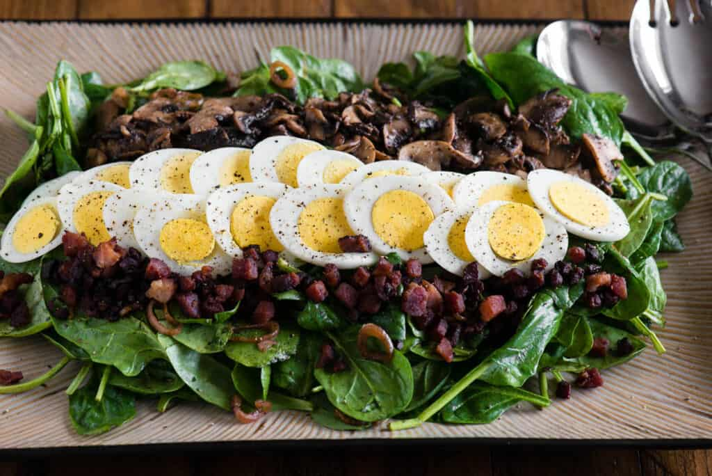 platter with Warm Spinach Salad with hard boiled egg
