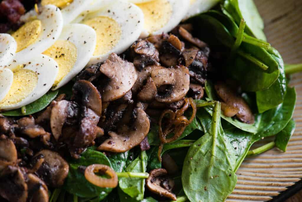 sautéed mushrooms on warm spinach salad