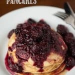 Homemade Whole Wheat Buttermilk Pancakes topped with berries