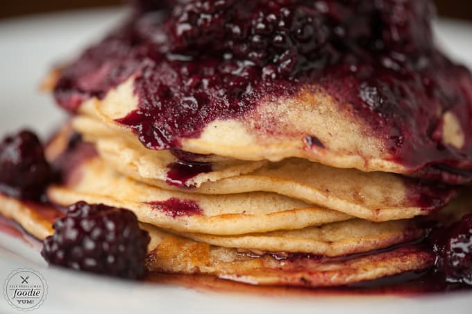 A close up of food on a plate, with Pancake and Berry