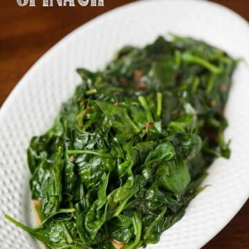 steamed garlic spinach on white plate