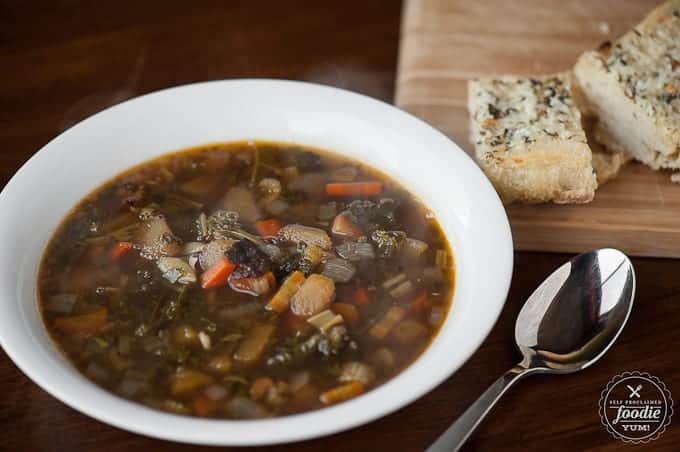 Homemade Winter Minestrone is a healthy and hearty winter soup full of cold weather favorites like kale, squash, beans, bacon, pasta, and savory beef brot